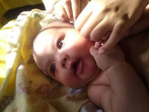 Dhuha, 2 months old, sunbathing with Ibu and Bapak :)